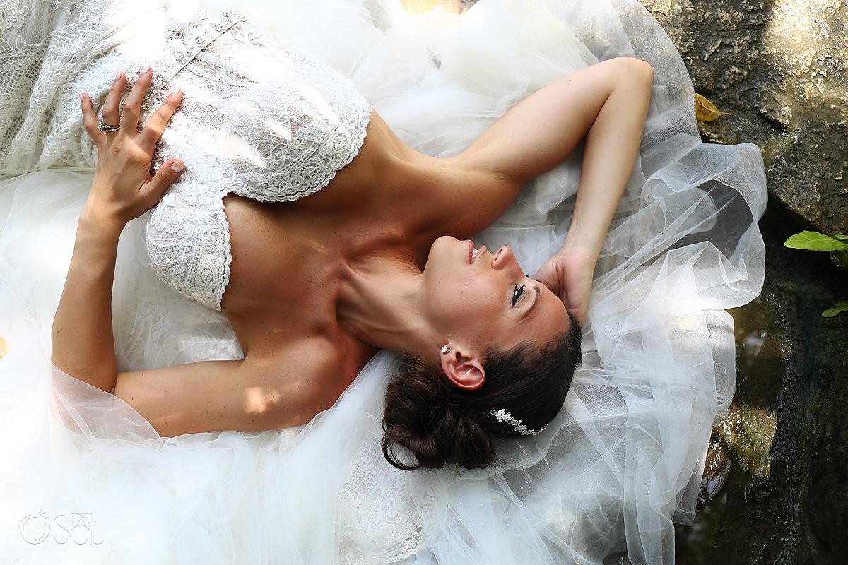 beautiful bridal portrait lying down cenote trash the dress Riviera Maya Mexico