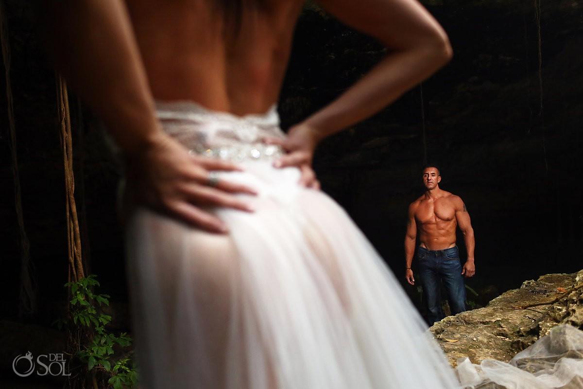 couples boudoir sexy wedding photo groom looking at bride cenote trash the dress Riviera Maya Mexico