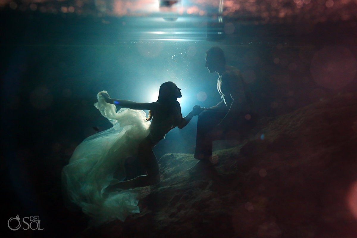 sexy and suggestive underwater silhouette Adam and Eve Trash the dress with white lace bridal lingerie bodysuit