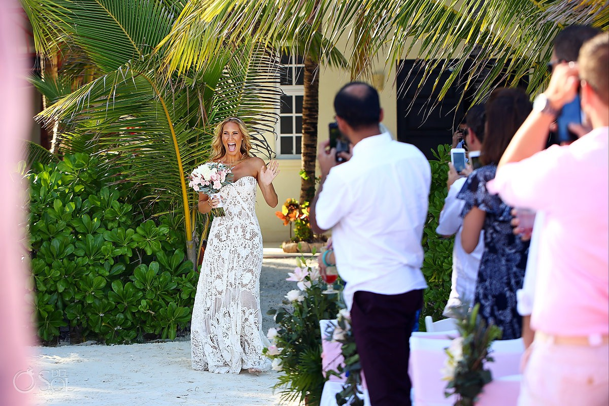 best bride entrance ever with a smile and a wave beach destination wedding El Dorado Maroma Playa del Carmen Mexico