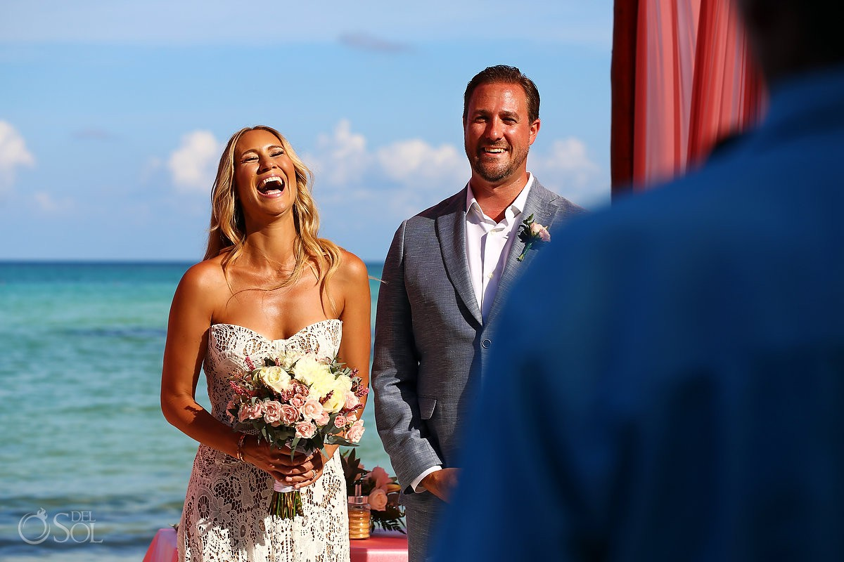 happy bride laughs beach destination wedding El Dorado Maroma Playa del Carmen Mexico