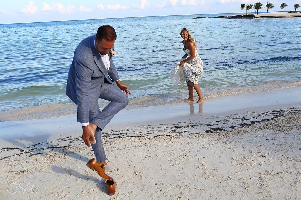candid portrait groom taking off shoes destination wedding El Dorado Maroma Playa del Carmen Mexico