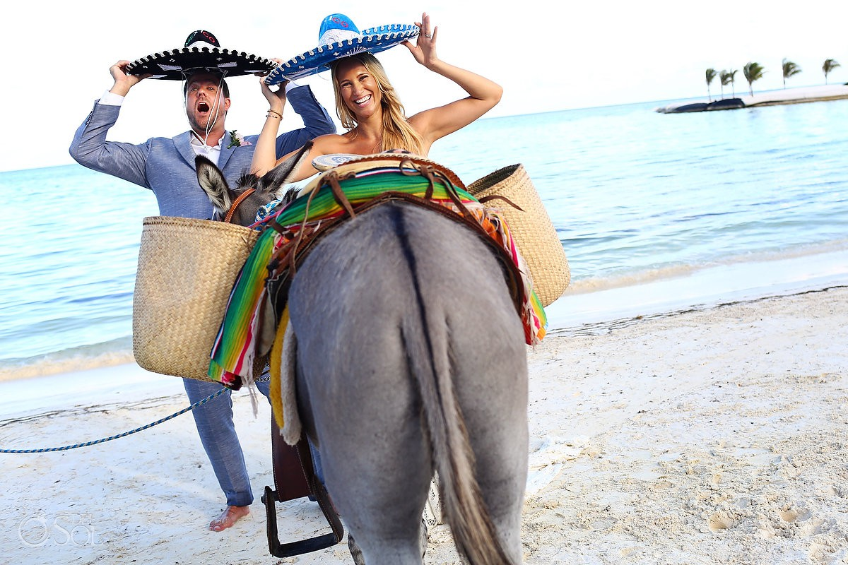 funny wedding photo with donkey ass and mexican sombreros destination wedding El Dorado Maroma Playa del Carmen Mexico