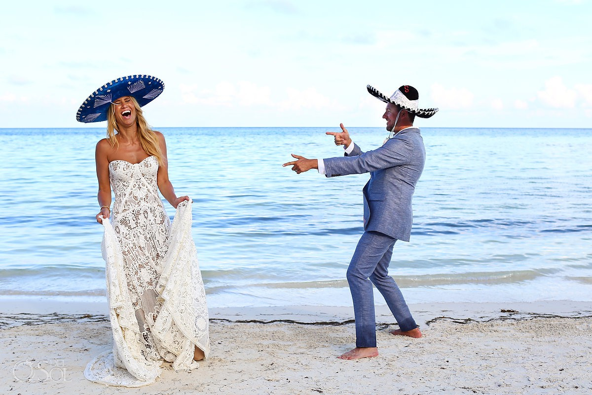 funny wedding photo bride and groom wearing Mexican sombreros destination wedding El Dorado Maroma Playa del Carmen Mexico