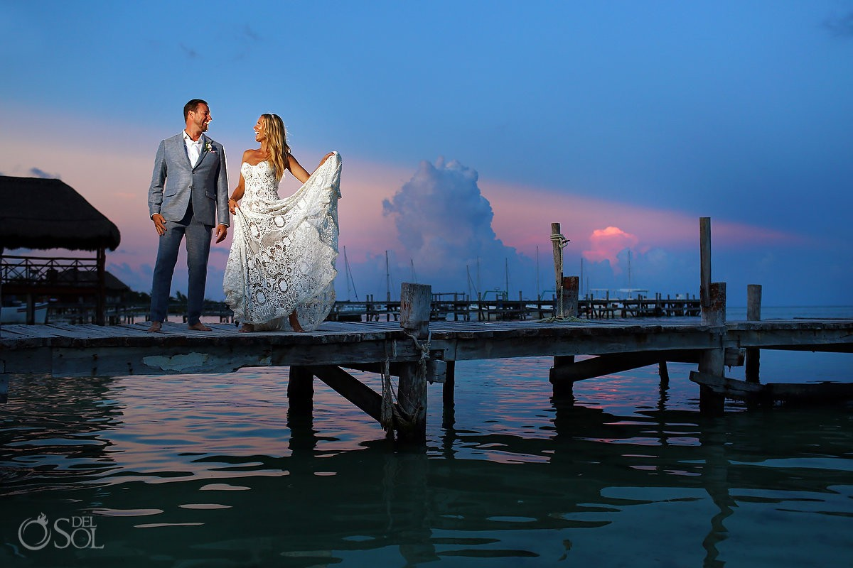 sunset wedding portrait on the pier beach wedding reception El Dorado Maroma Playa del Carmen Mexico