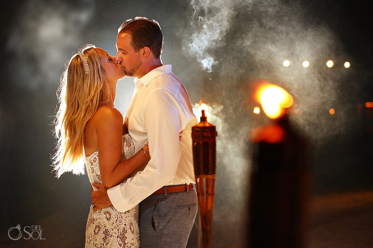 creative night portraits with Tiki torches beach wedding reception El Dorado Maroma Playa del Carmen Mexico