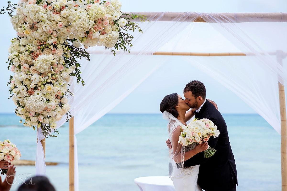 Bride and groom first kiss Grand Velas Riviera Maya Playa del Carmen Mexico.