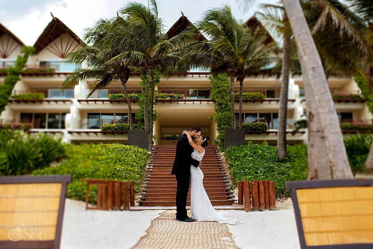 Bride and groom Romantic Destination beach wedding portrait Grand Velas Riviera Maya Playa del Carmen Mexico.