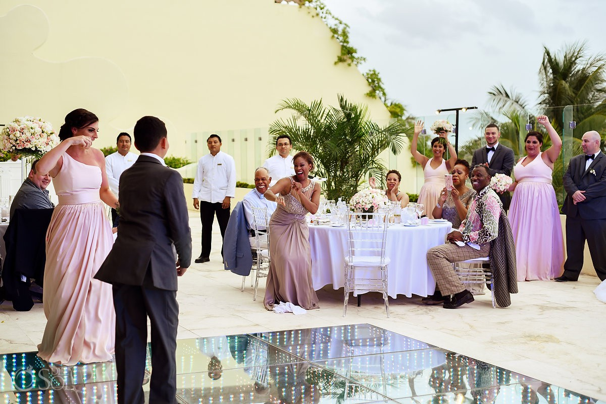 Wedding reception guest having fun Grand Velas Riviera Maya Playa del Carmen Mexico.