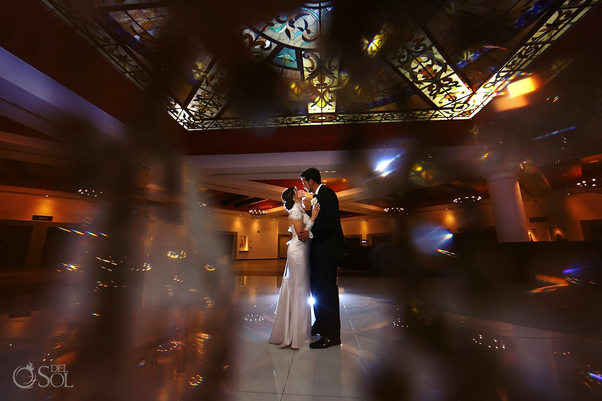 Wide angle bride and groom romantic wedding portrait Guadalupe Chapel Xcaret Park and Hotel Hard Rock Riviera Maya Mexico