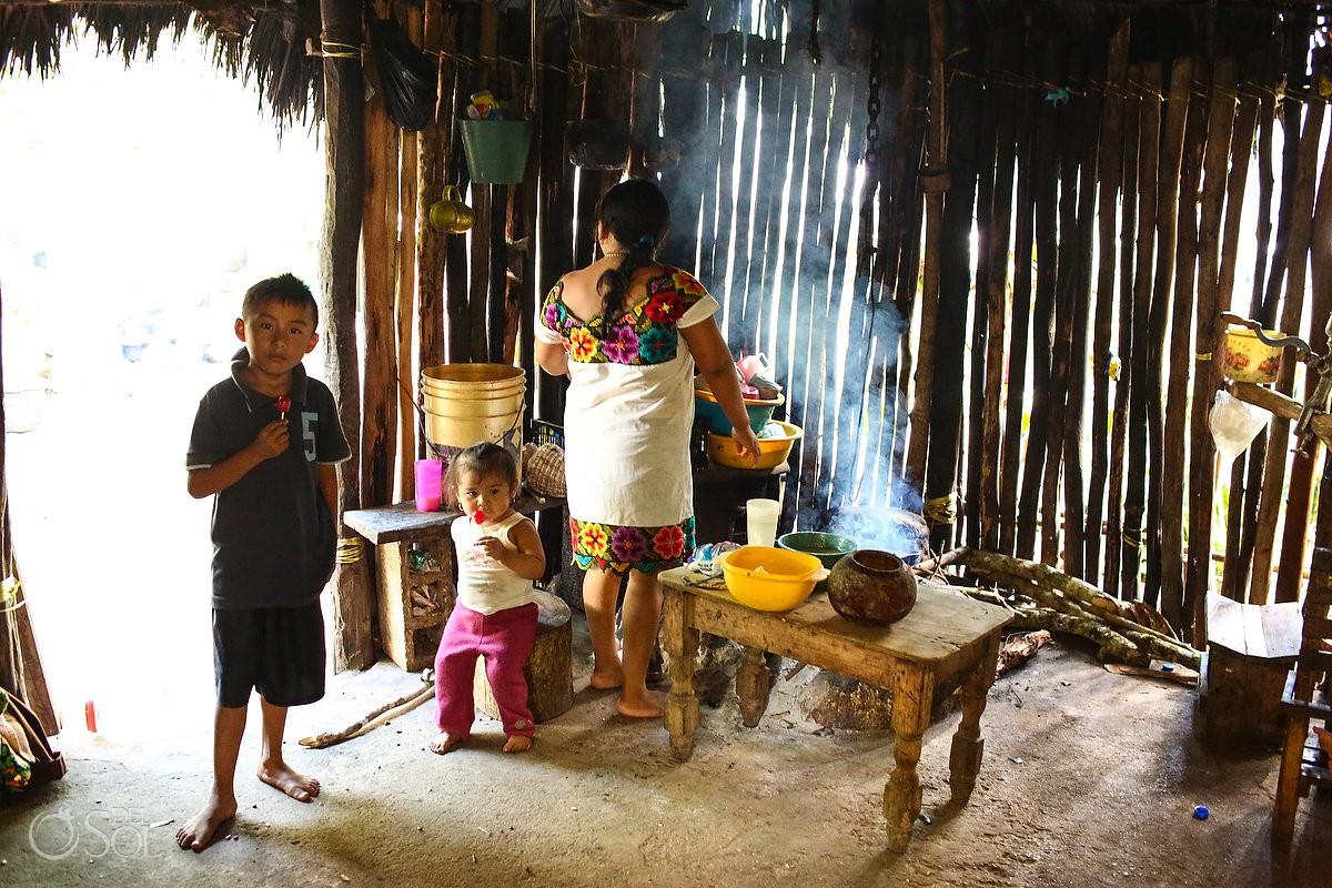 Mayan woman prepares handmade tortillas and egg at Mayan Village in Mexico