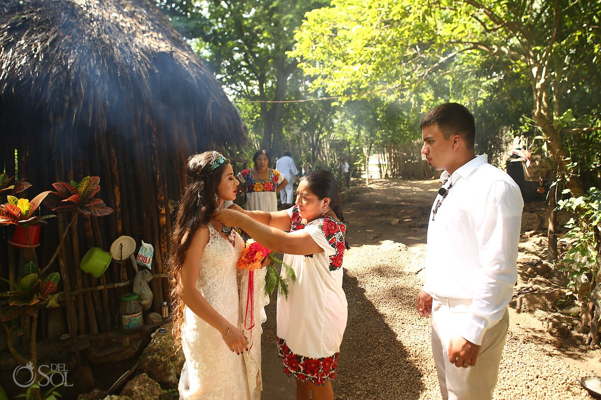 Mayan woman gives handmade necklace to bride as a wedding day present