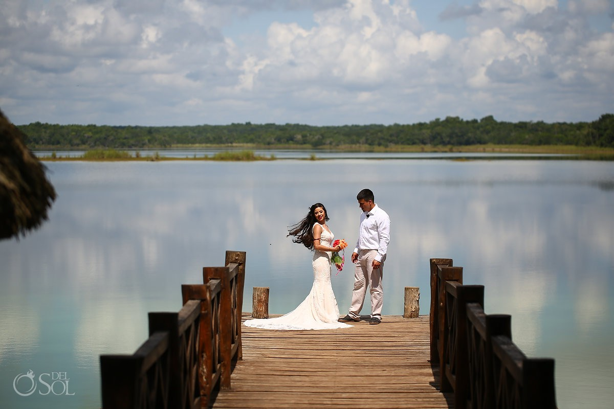 Bride and groom at lagoon in Mexico before Trash the Dress photoshoot