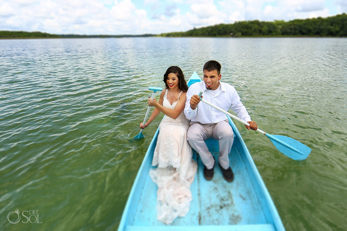 Bride and groom paddling at lagoon Rivera Maya Trash the Dress photoshoot