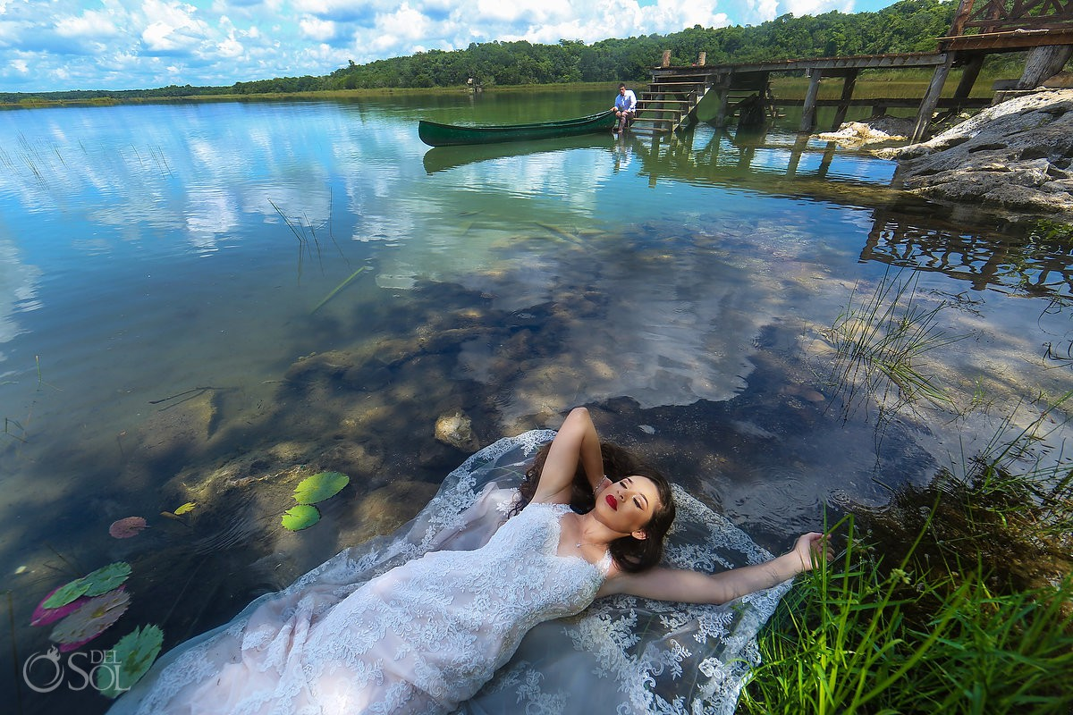 Bride floating in lagoon Trash the Dress photoshoot Riviera Maya Mexico