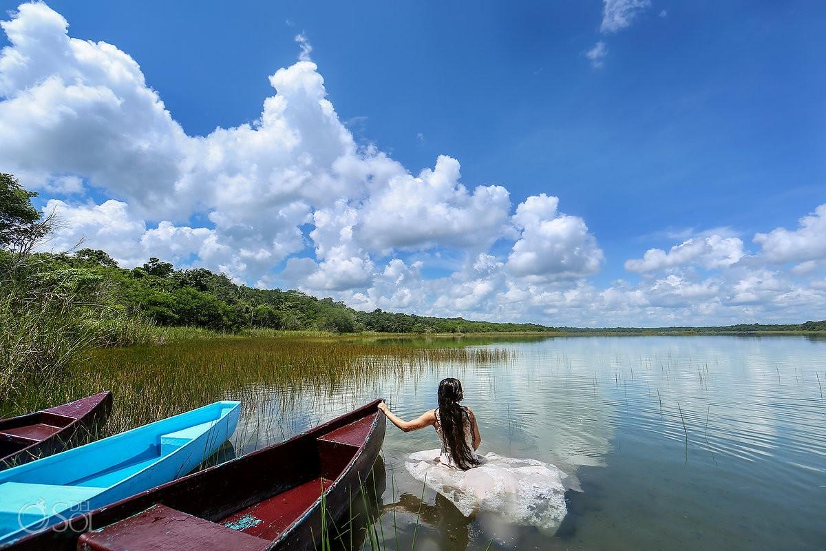 Bride overlooking clear water lagoon Riviera Maya Trash the Dress