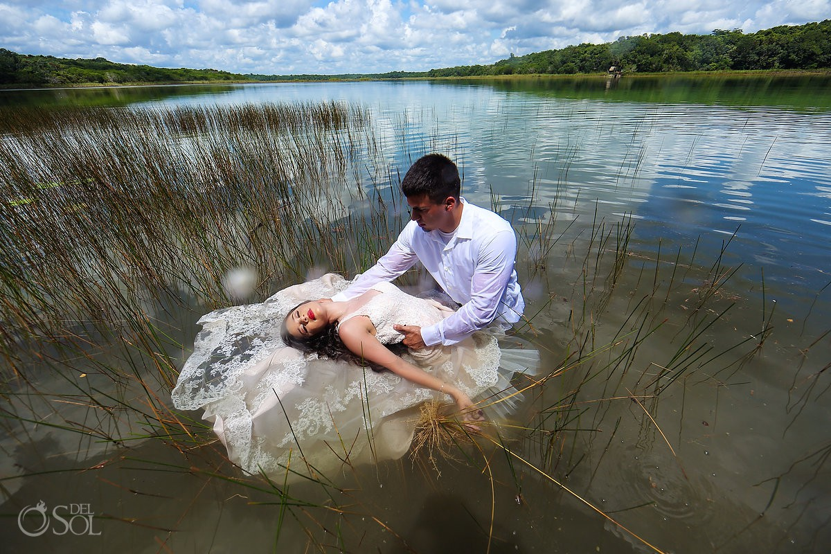 Bride and groom Trash The Dress at lagoon Riviera Maya reflection of clouds in clear water