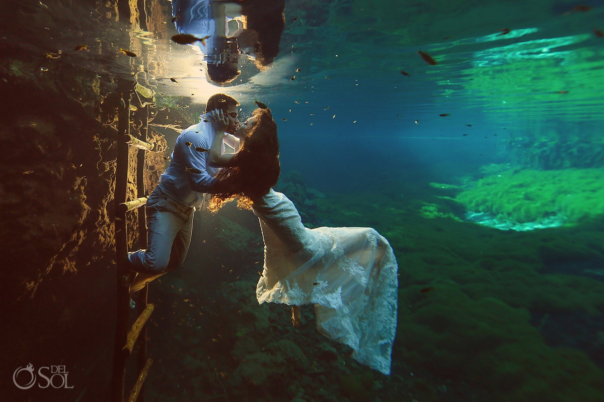 Underwater Trash the Dress photoshoot at cenote with bride and groom green water