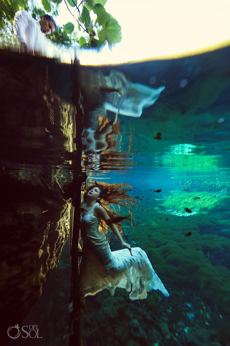 Underwater photoshoot Trash the Dress with bride at cenote in Riviera Maya Mexico green light