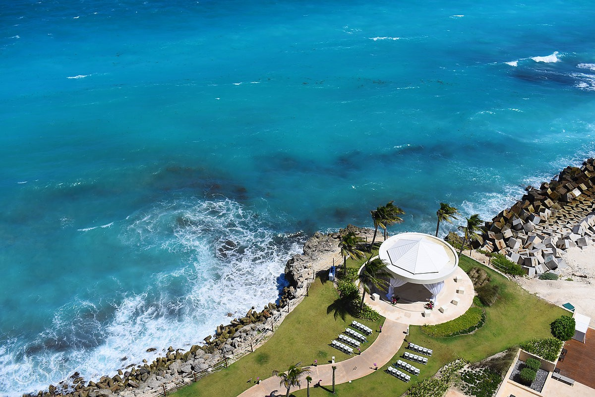 Hyatt Ziva Wedding Photography cliff side gazebo amazing destination wedding venue surrounded by Caribbean Ocean Cancun Mexico