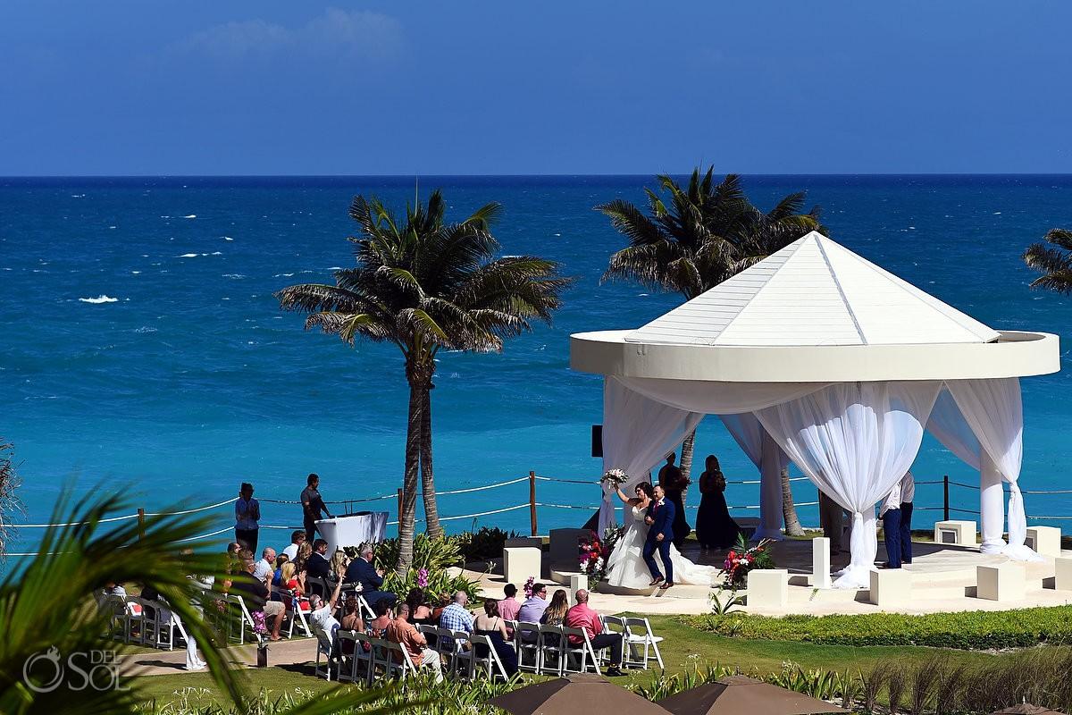 Wedding photography Hyatt Ziva couple celebrating cliffside gazebo amazing destination wedding venue Cancun Mexico