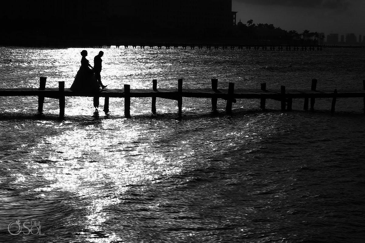 Bride and groom walking on pier Hyatt Ziva Cancun