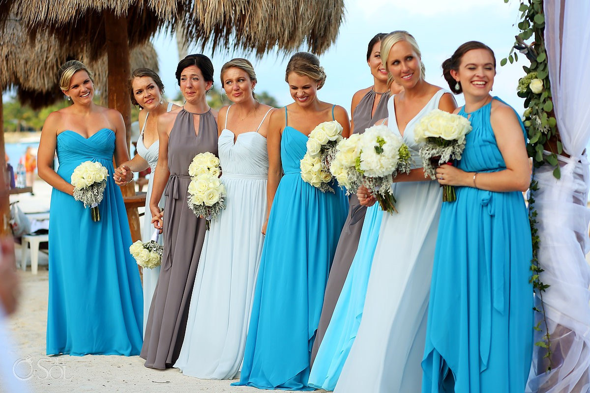 bridesmaids in long blue mismatched bridesmaids dresses watching gay wedding ceremony secrets Akumal Mexico