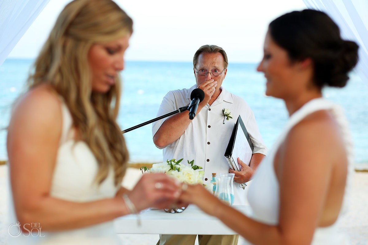 emotional officiant bride and bride ring exchange same sex destination wedding Secrets Akumal Riviera Maya Mexico