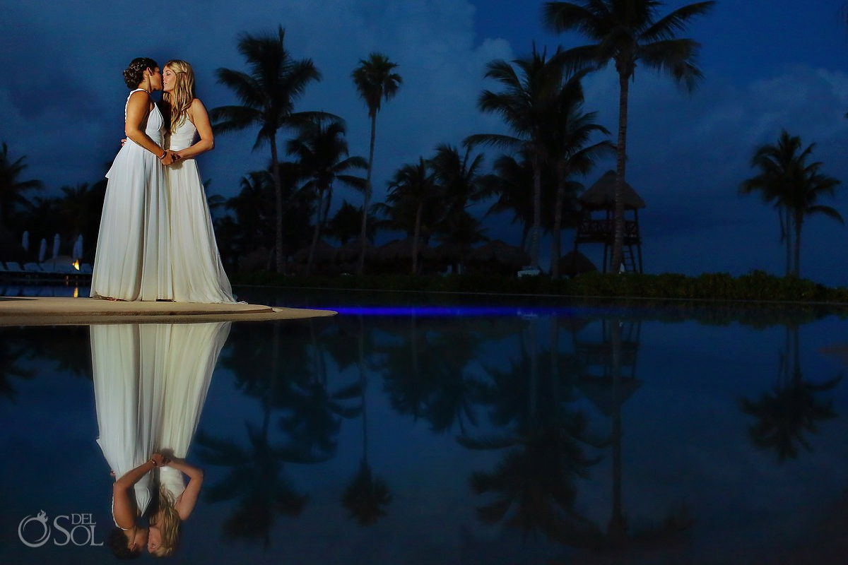 Bride and Bride night portrait reflection Secrets Akumal Riviera Maya mexico