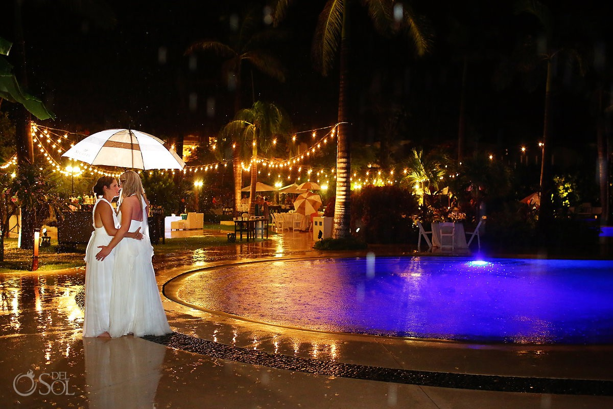 same sex bride and bride rain photo gay destination wedding Secrets Akumal Riviera maya Mexico