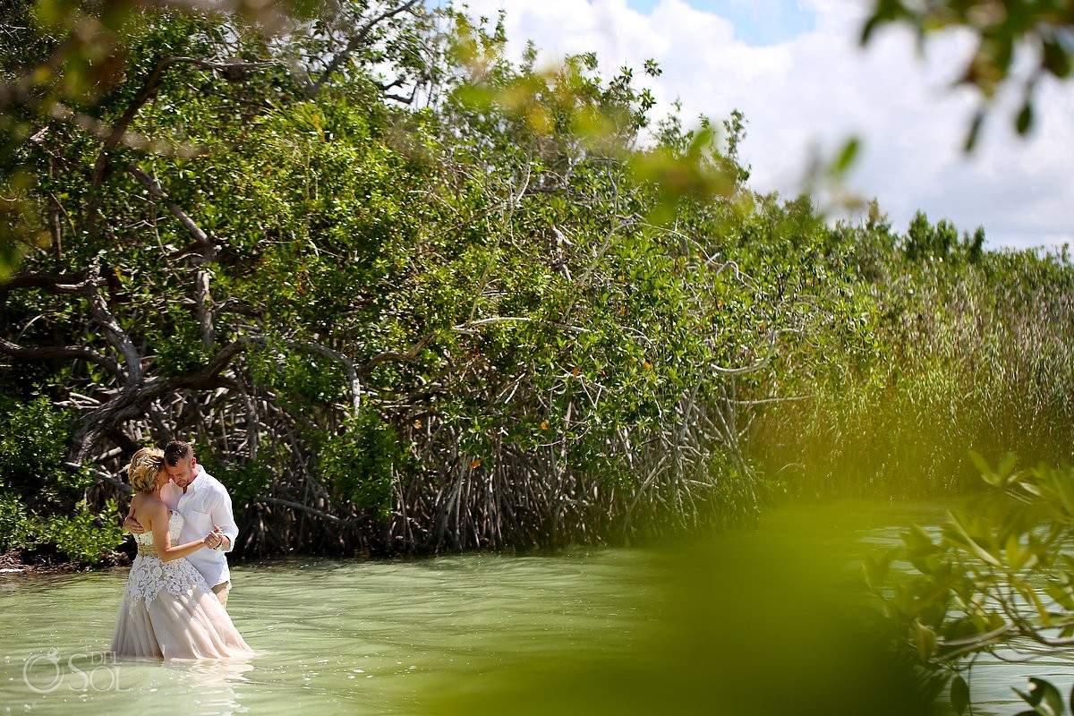 Bride and groom beach first dance love in middle nature Mexico Tulum Riviera Maya
