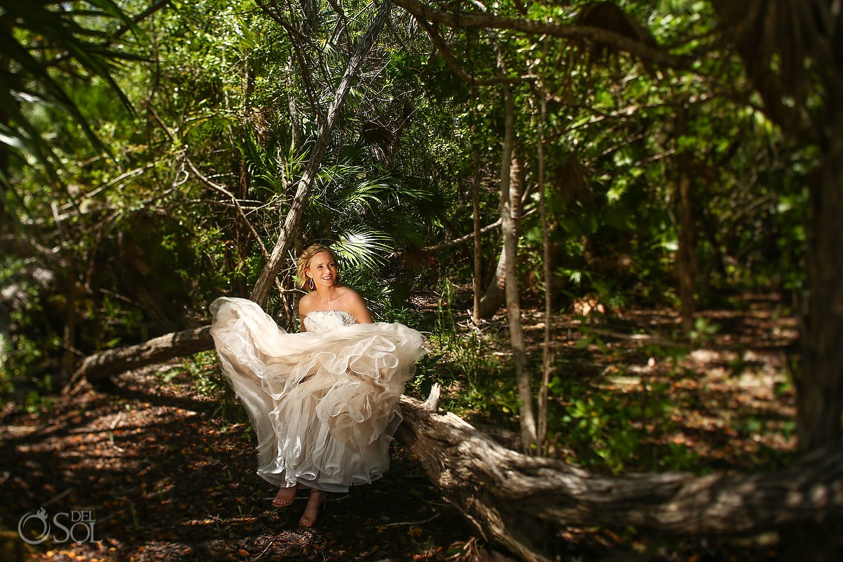 bride playing with wedding dress dancing in the jungle Tulum Riviera Maya
