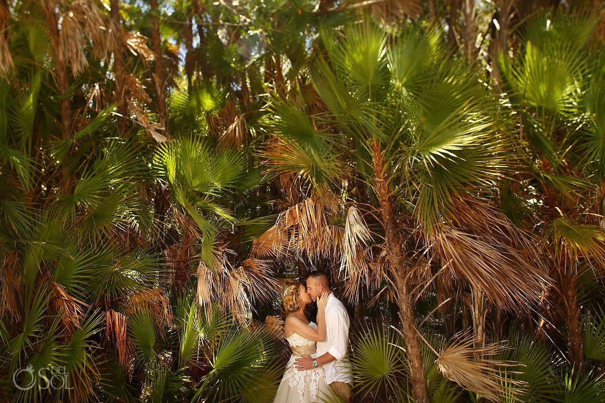Bride and groom giving kiss romantic wedding portraits Tulum México