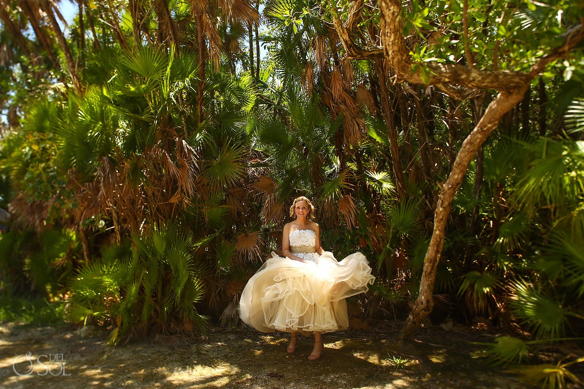 Bride dancing wedding dress middle of jungle Tulum Mexico