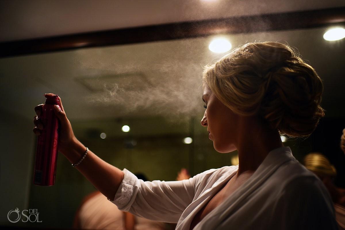 artistic getting ready photo candid portrait bride spraying hair getting ready Dreams Tulum Riviera Maya Mexico