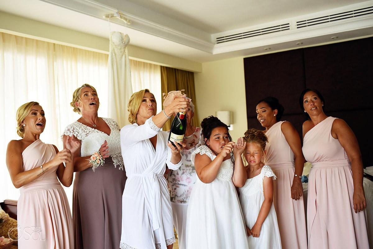 funny wedding photo bride opening champagne getting ready Dreams Tulum Riviera Maya Mexico