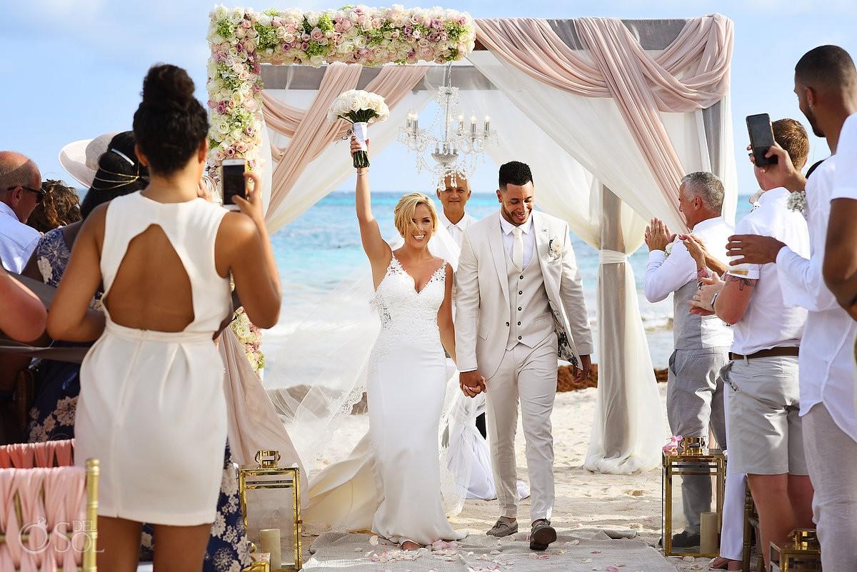 celebration bride and groom exit, beach wedding Dreams Tulum Riviera Maya Mexico