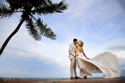 romantic destination wedding portrait on the beach under a palm tree dress blowing in the wind #TravelForLove