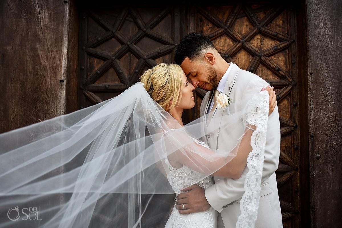 romantic wedding portrait outside Dreams Tulum chapel with wooden door texture