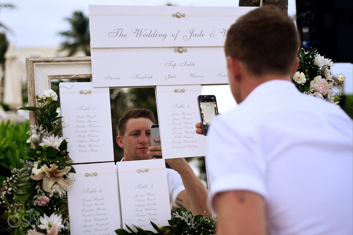 framing the subject wedding guest taking photo of mirrored seating chart Dreams Tulum Riviera Maya Mexico