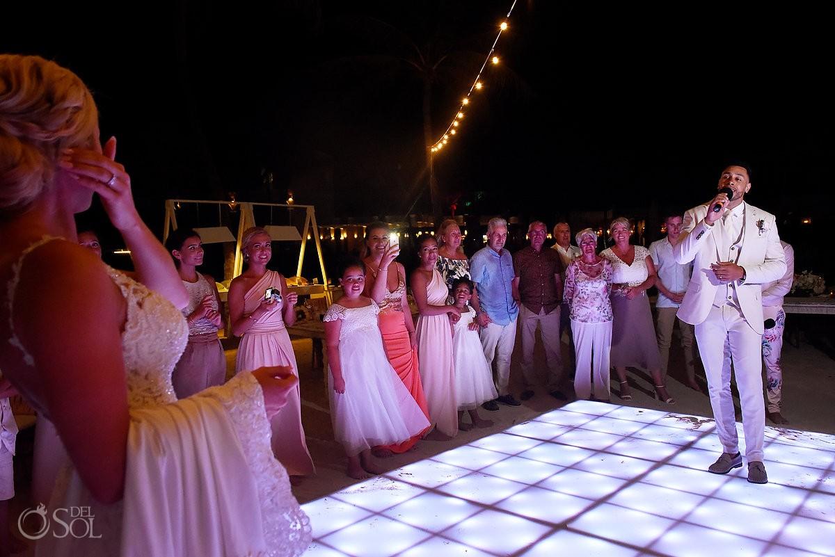 groom serenades bride first dance destination wedding reception Dreams Tulum Riviera Maya Mexico