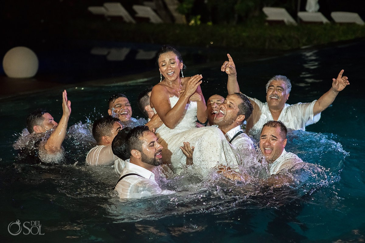 Bride get wet at pool Grand Velas Riviera Maya Playa del Carmen Mexico