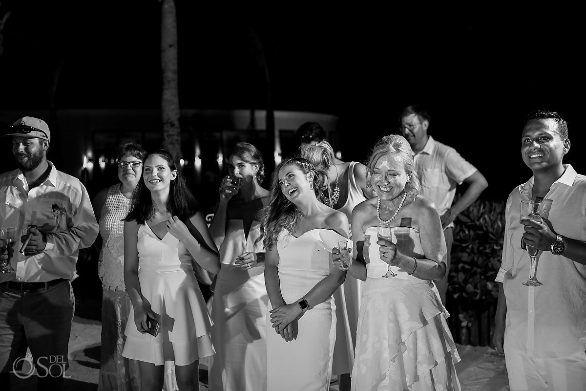 Wedding guest having fun toast time Dreams Tulum Riviera Maya Mexico