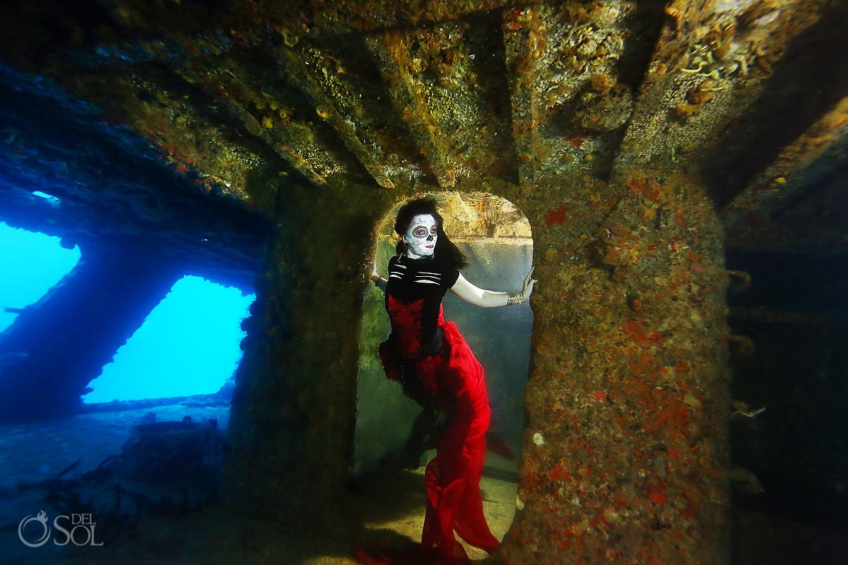 Polly at underwater photoshoot in shipwreck wearing red mermaid tail mexico #aworldofitsown