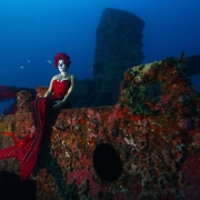 Iris Vasconez as Catrina Sirena sitting on shipwreck artificial reef conservation project