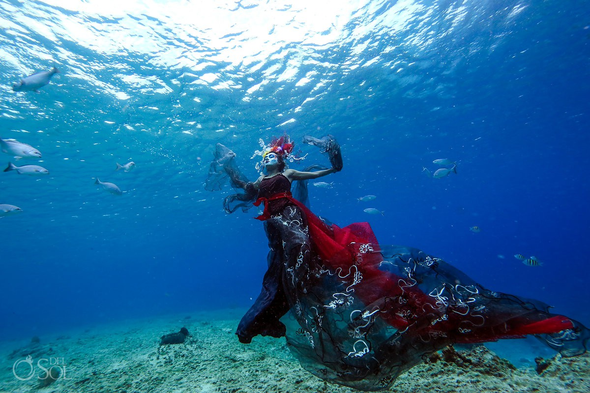 Underwater photography with Day of the Dead Catrina at coral reefs in Cozumel conservation project