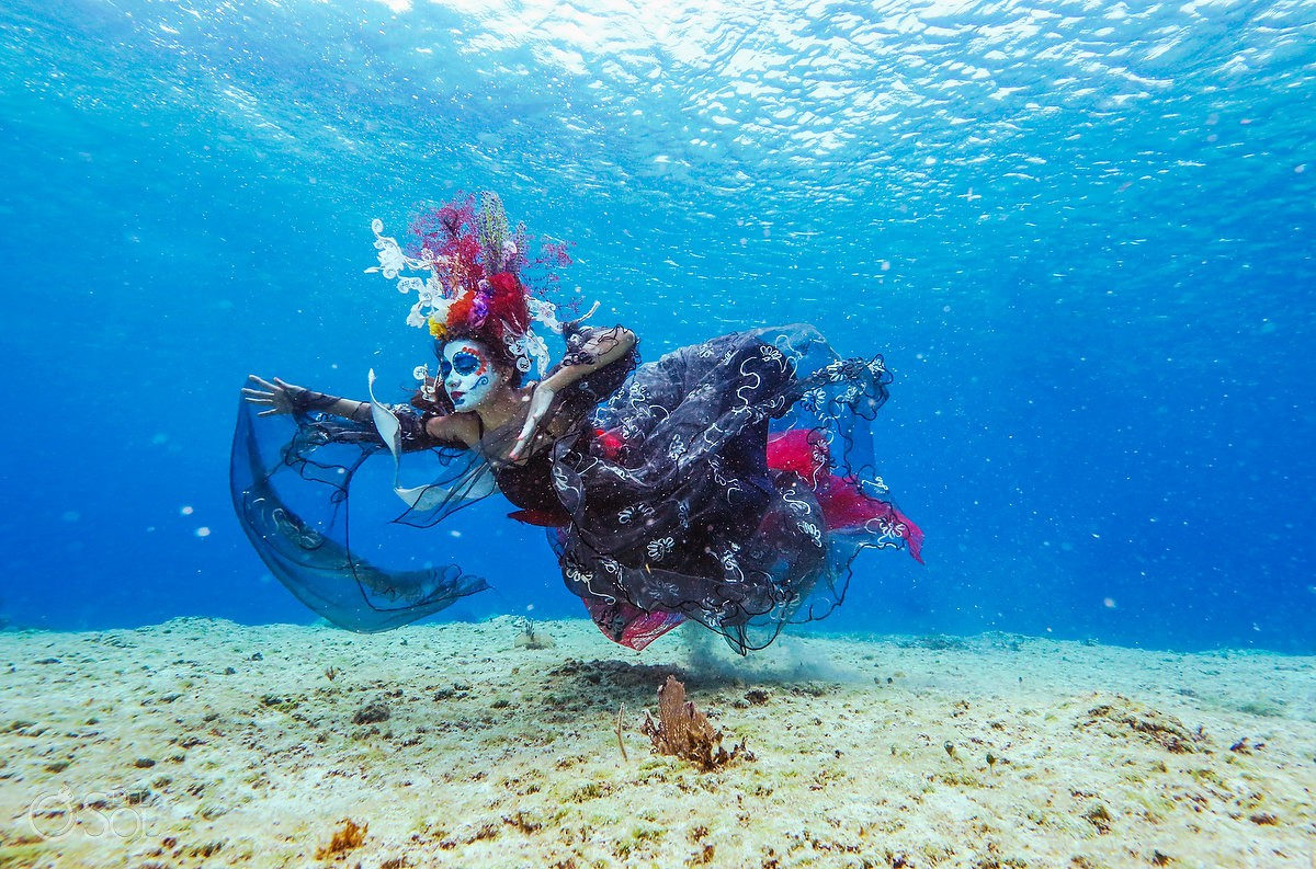 Cozumel Mexico #aworldofitsown Day of the Dead underwater photoshoot with Frida Lemus free diver Catrina swimming around dead coral reef conservation project