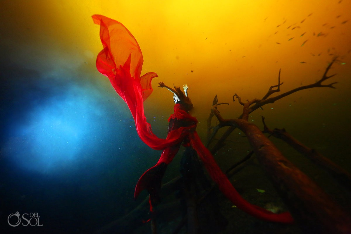 Day of the Dead underwater photography yellow water cenote Tulum red dress