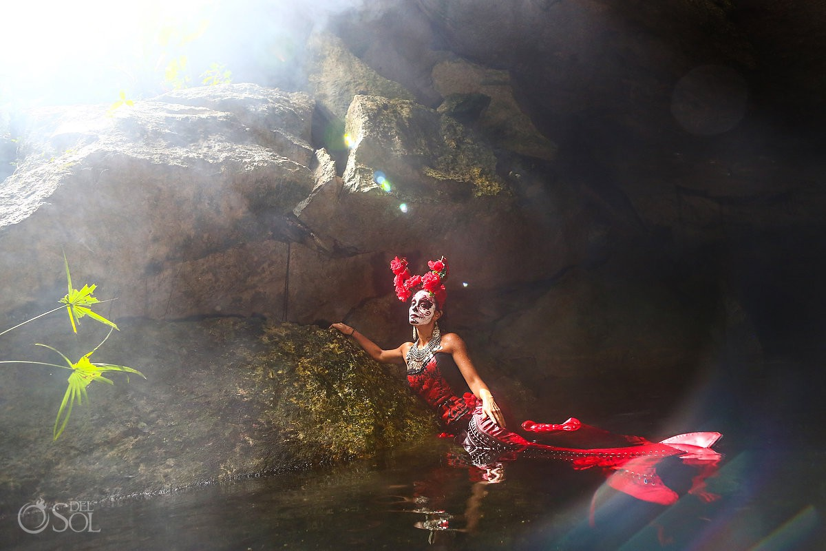 Day of the Dead Catrina at cenote Riviera Maya red dress