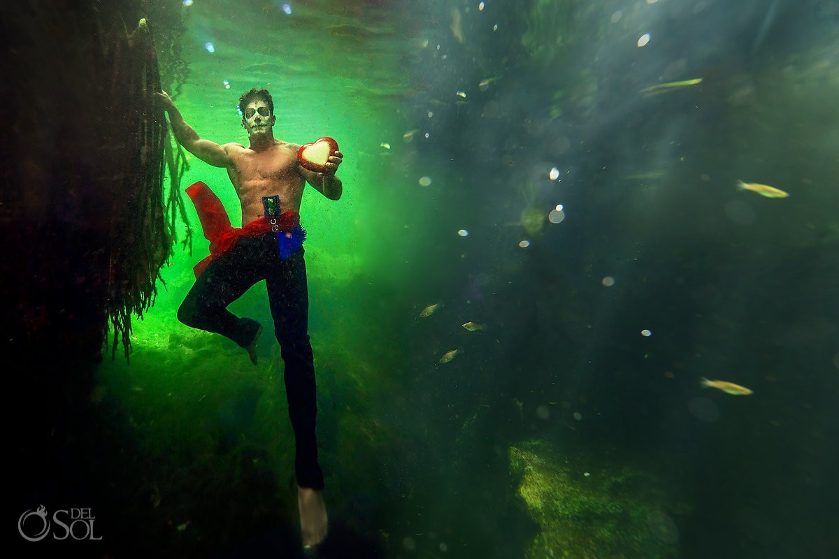 Day of the Dead Catrin holding heart underwater photography green water cenote